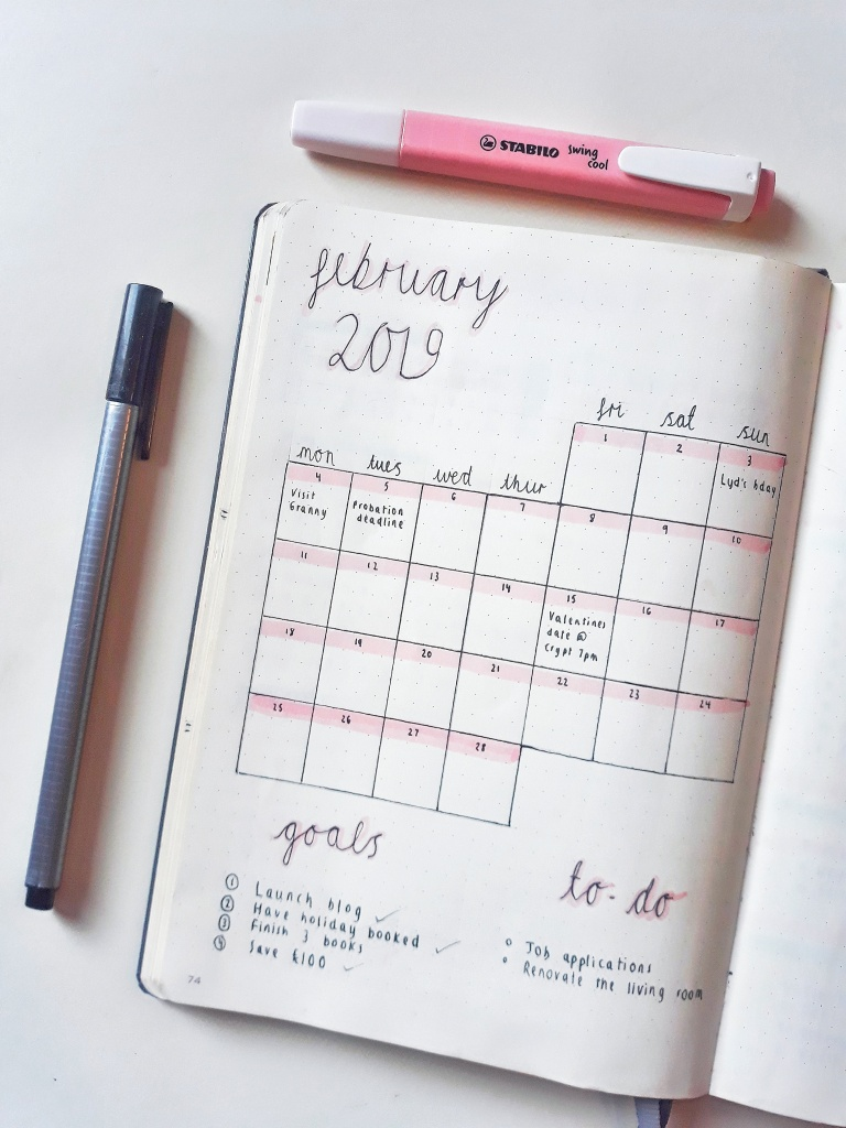 My bullet journal February monthly log, featuring a calendar, my goals and to-do list.